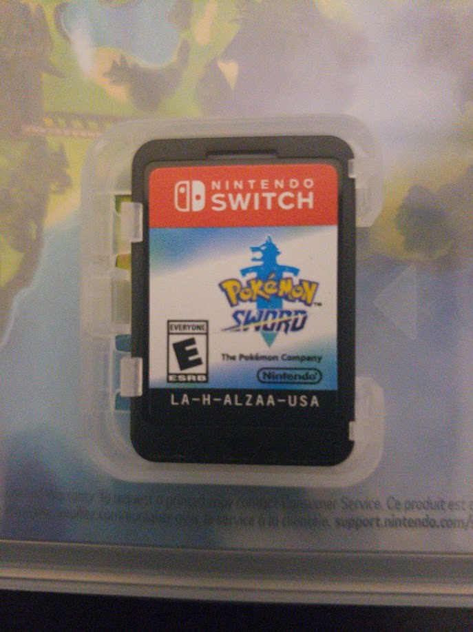 Pokémon Sword - Game Cart inside the box