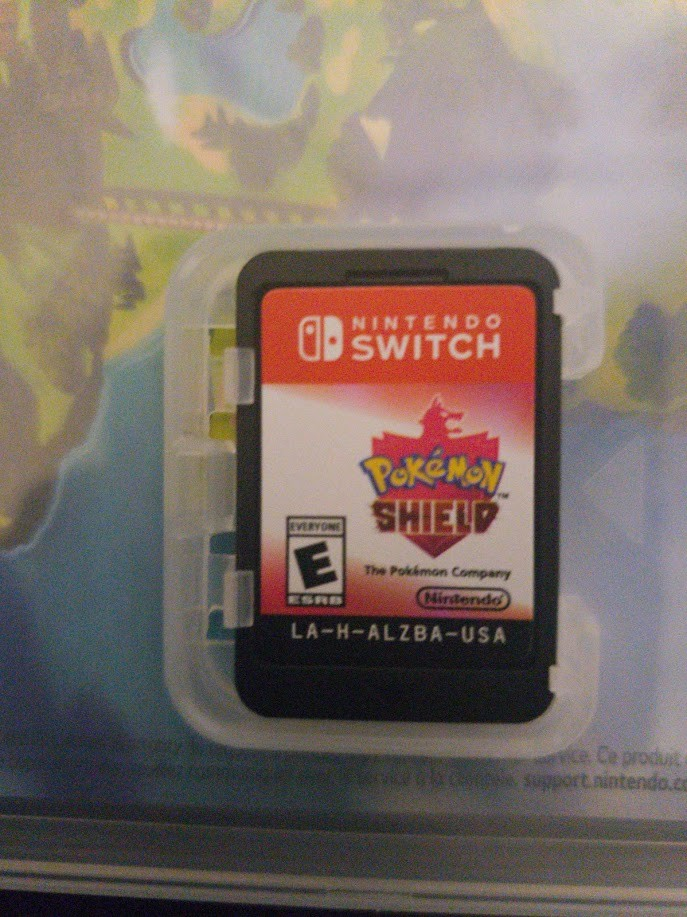 Pokémon Shield - Game Cart inside the box