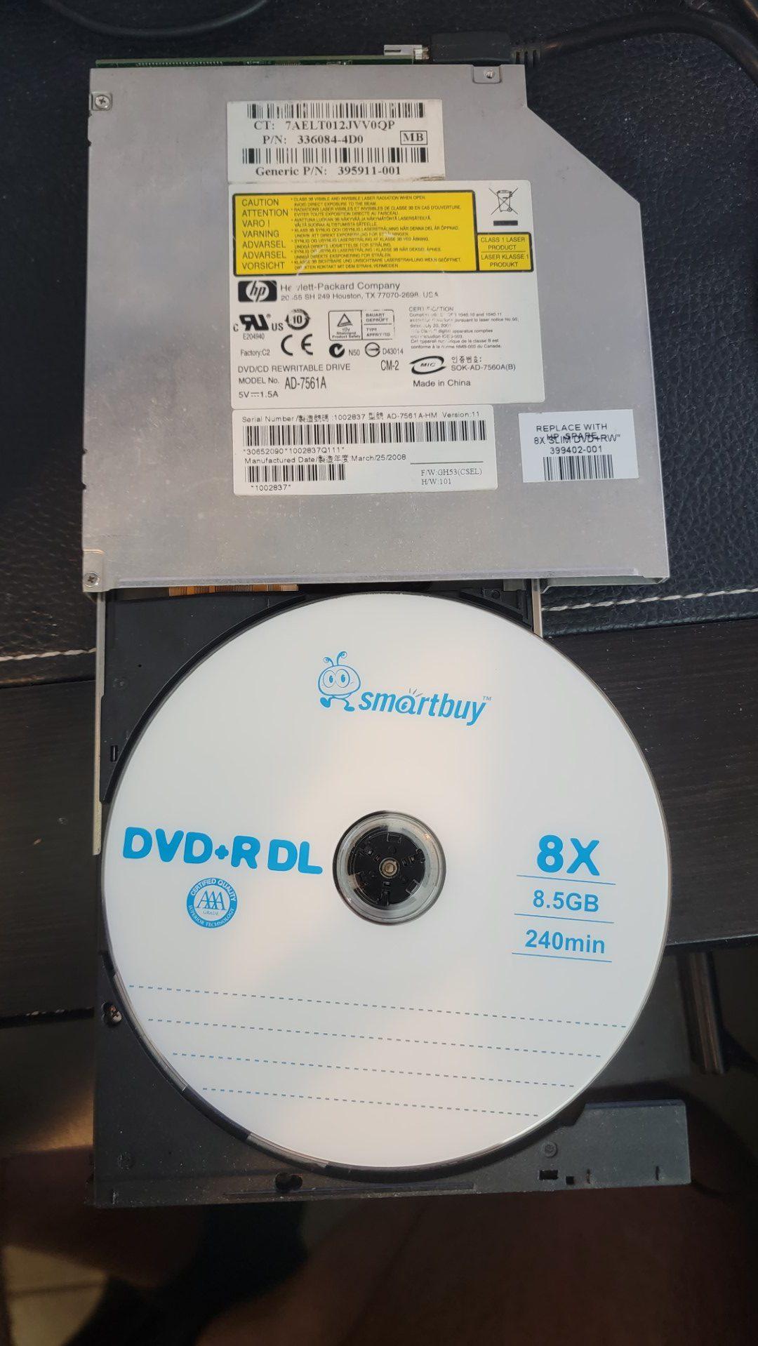Optiarc AD-7561A with SmartBuy DVD+R DL